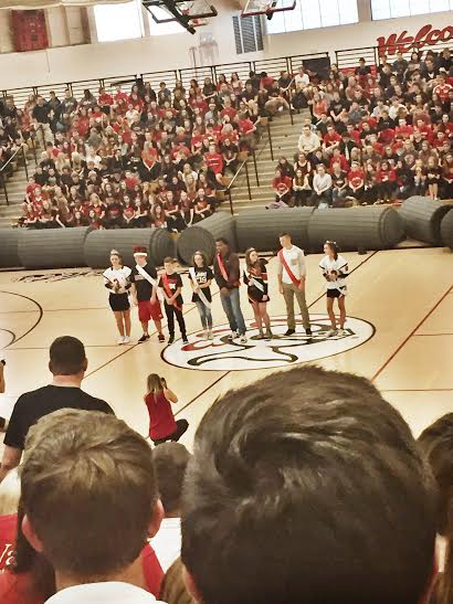 The 2015 Homecoming Court accepts their crowns at the pep assembly