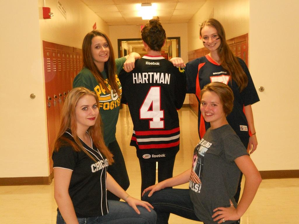 Sam Mitchell, Bethany Kratochvil, Alaina Thompson, Amy Zajac, and Riley McLaughlin model their sports attire on Sandlot Sports Day