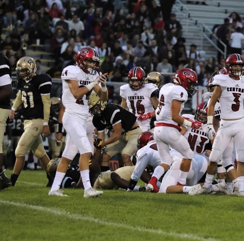 Junior Ian Troester celebrates after a tackle against Lockport